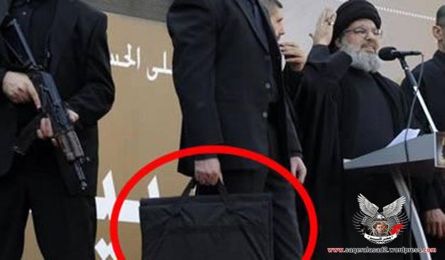 ماذا بداخل الشنطة التي يحملها مرافق السيد حسن نصرالله؟